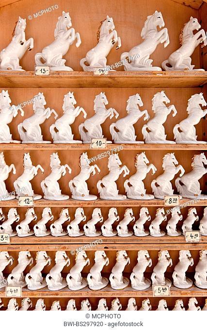 rack filled with porcelain horses