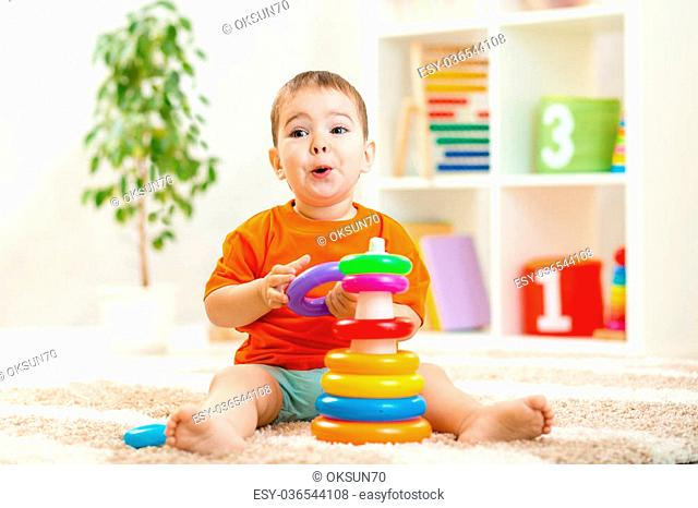 funny child boy playing with toy indoor