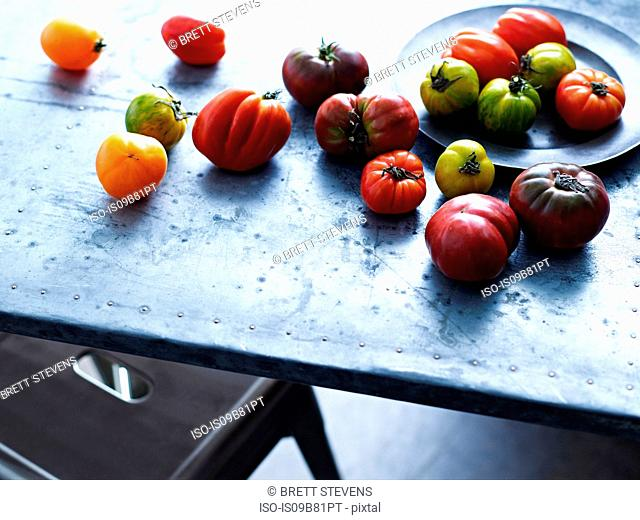 Selection of heirloom tomatoes on table, close-up