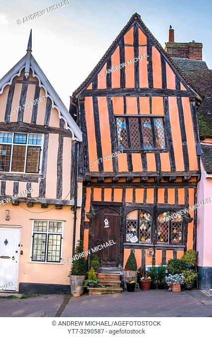 15th century Crooked House antiques shop and tearooms in quaint wonky crooked orange timbered building in High Street, Lavenham, Suffolk, England, UK
