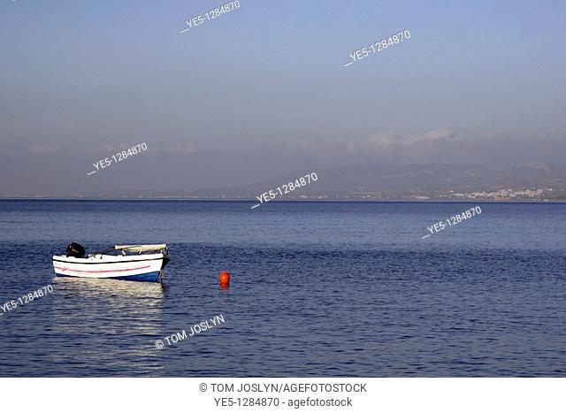 Small boat moored off shore , Lothiarika , near Lardos , Rhodes , Greece