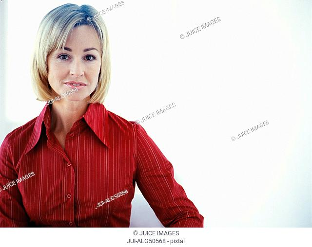 Portrait, blonde woman in red shirt