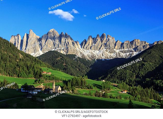 The village of St. Magdalene surrounded by green meadows at the foot of the Odle Funes Valley South Tyrol Dolomites Italy Europe