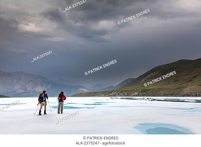 Hikers travel the aufies on the Marsh Fork of the Canning river, Arctic National Wildlife Refuge in the Brooks range mountains, Alaska