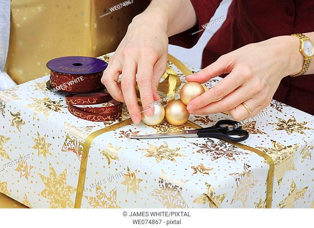 Woman wrapping up Christmas present, Christmas gift