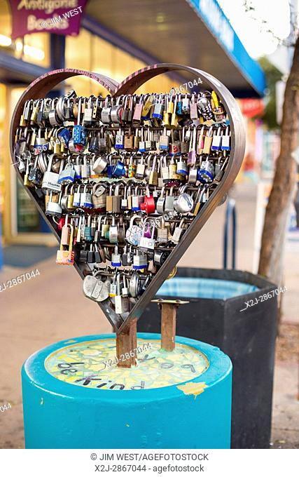 Tucson, Arizona - Lock Your Love sculpture on Fourth Avenue. Sweethearts inscribe their names on a local, place it on the sculpture