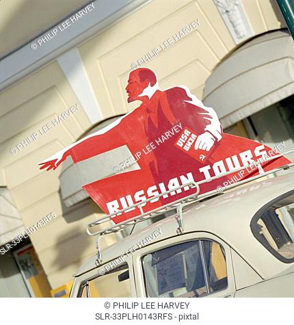 'Russian Tours' sign on top of car