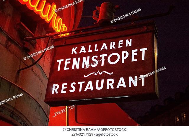 STOCKHOLM, SWEDEN. Tennstopet Restaurant entrance front exterior neon signs at night on December 29, 2019 in Stockholm, Sweden
