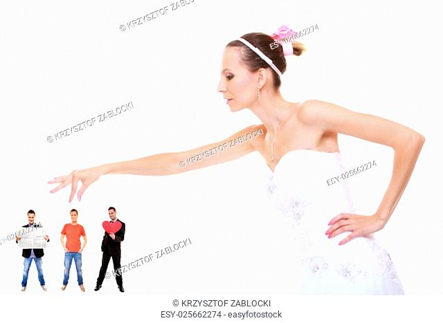 young woman in wedding dress bride choosing the perfect candidate for husband. isolated