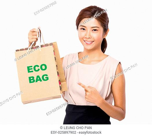 Asian woman finger point to shopping bag and showing phrase of eco bag