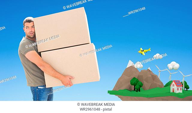 Delivery man carrying parcels with cliff in background