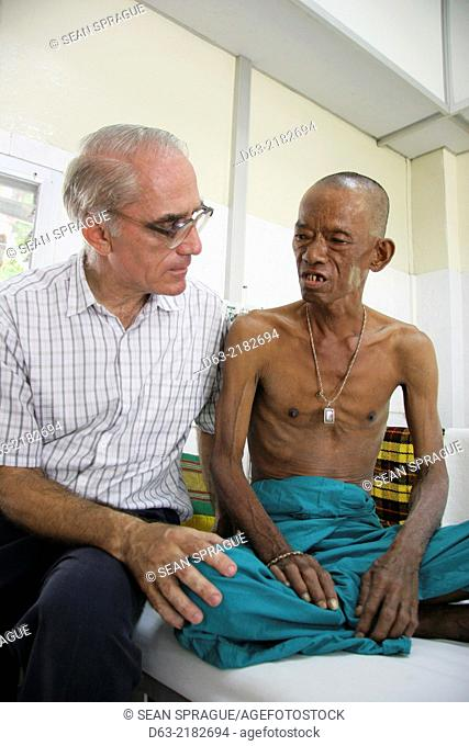 THAILAND. AIDS hospice at a Buddhist temple in Lampung. American missionary priest voluteering his services to help the dying