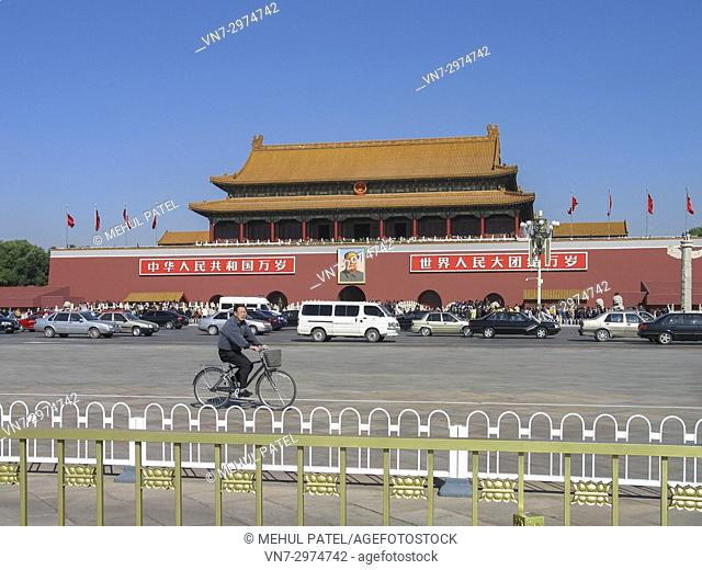 Cyclist cycling on Tian'anmen Square in front of Tian'anmen Gate in Beijing, China