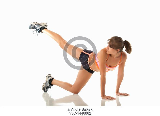 Hispanic woman stretching at fitness exercise
