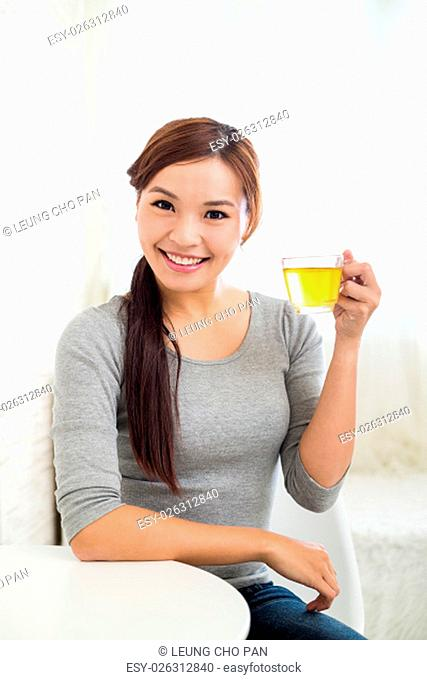 Young Woman hold a glass of tea