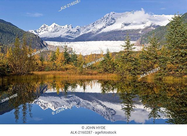 Fall Foliage Reflects In A Lake Near Mendenhall Glacier Near Juneau. Fall In Southeast Alaska