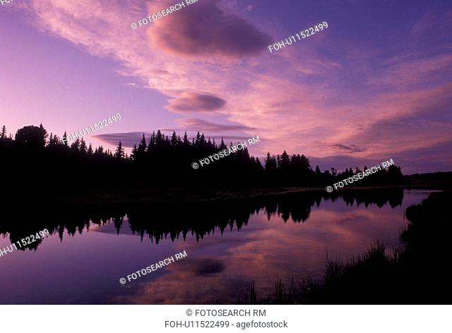 Grand Teton National Park, Snake River, Jackson Hole, WY, Wyoming, Scenic view of the clouds and trees reflecting in the calm waters of the Snake River at...