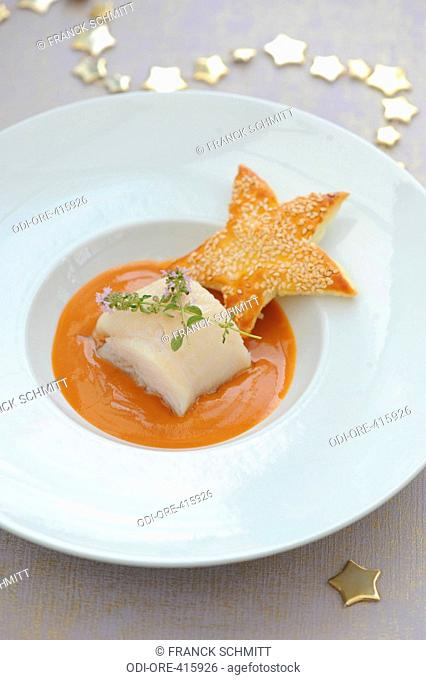Turbot fish with sauce and star cracker