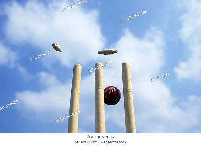 Close up of a cricket ball striking a wicket