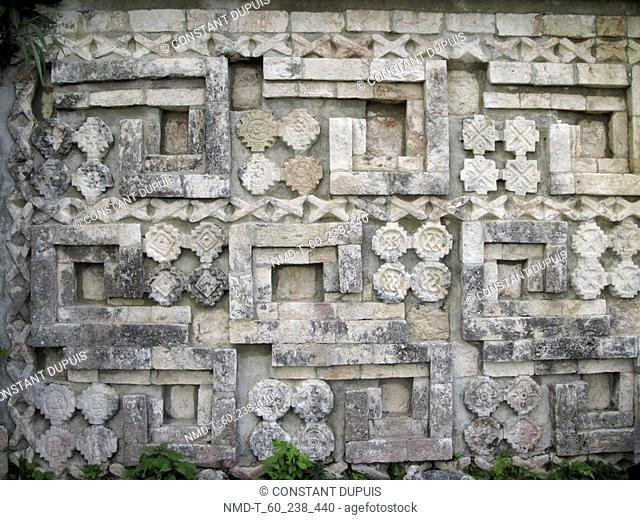Carvings on a stone wall, Great Pyramid, Uxmal, Yucatan, Mexico