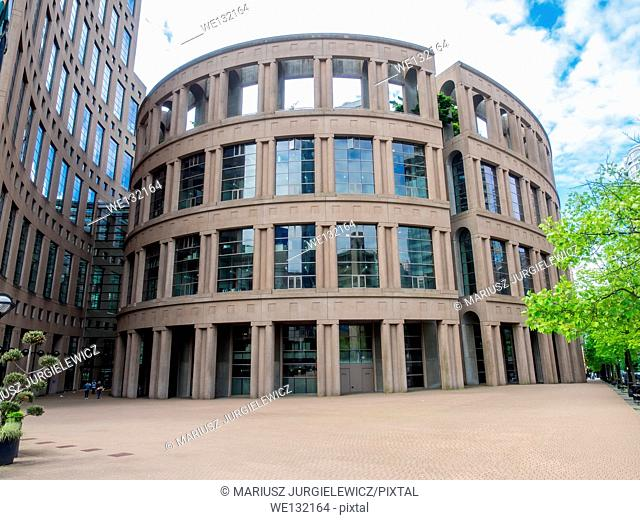 Vancouver Public Library's Central Branch is nine-story rectangular box containing book stacks and services, surrounded by a free-standing, elliptical