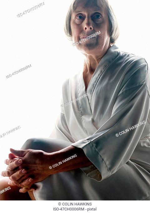 Older woman wearing bathrobe