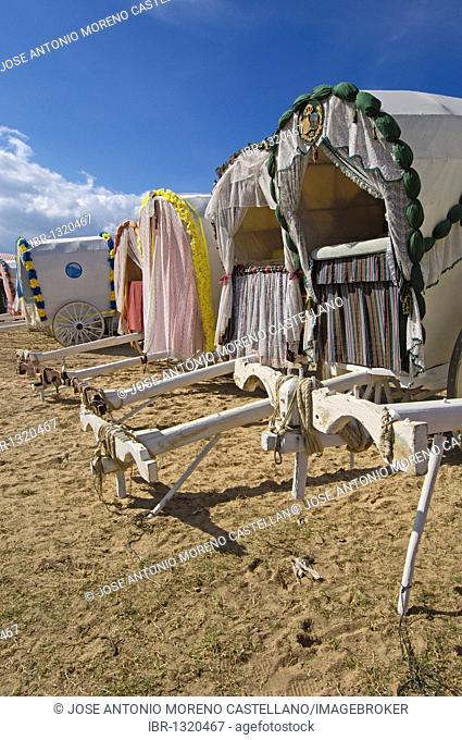 Typical carriages at El Rocio village, Romería, pilgrimage, to El Rocío, Almonte, Huelva province, Andalucia, Spain, Europe