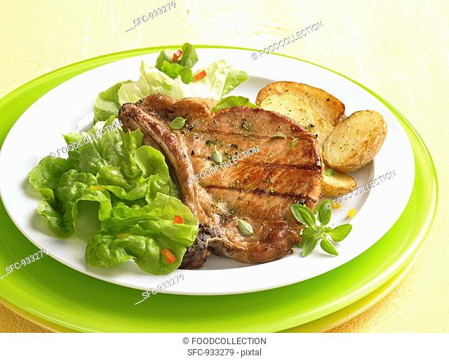 Grilled pork chop with fried potatoes