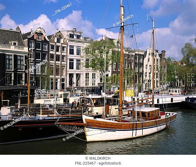 Boats moored at harbor, Amstel River, Amsterdam, Netherlands