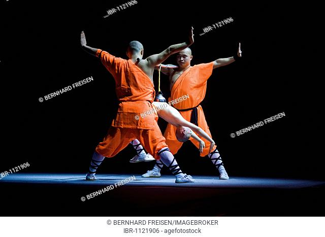 Concentration is keeping up the vaccum in the bell jar, enabling the child to hang on the rope, Shaolin monks during a show on the 22nd of March 2009 in Berlin