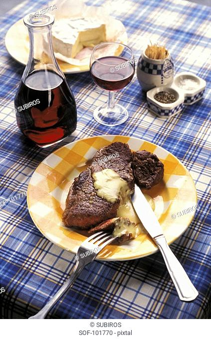 Grilled beef steak with camembert sauce