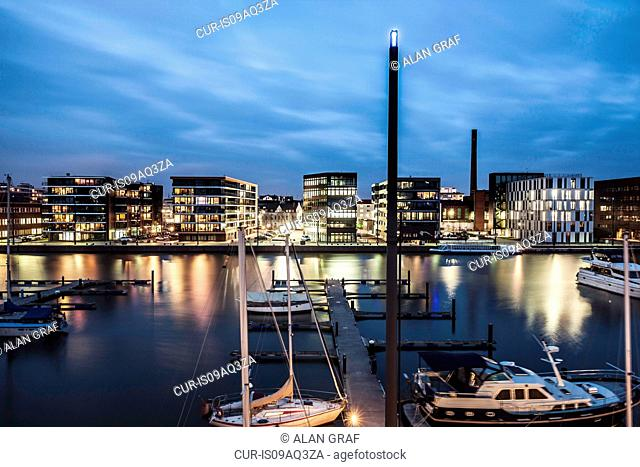 View of waterfront and moored boats at dusk, Bremerhaven, Germany