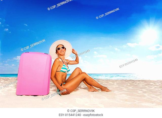 Happy woman with baggage on vacation