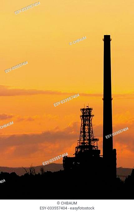 Karlsruhe's oil refinery in front of a colorful summer sunset