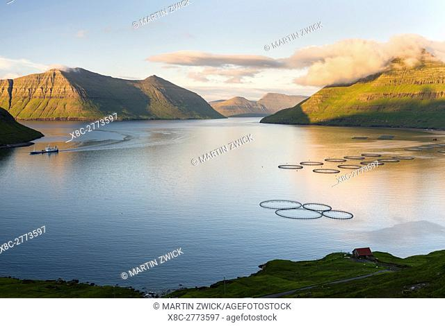 Fjord Fuglafjordur and Leirviksfjordur at sunset, in the background the mountains of the island Kalsoy. The island Eysturoy one of the two large islands of the...