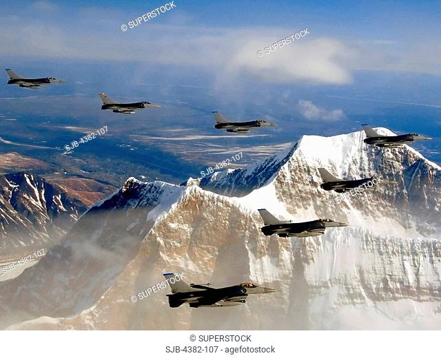 F-16s Flying in Formation Over Mountains