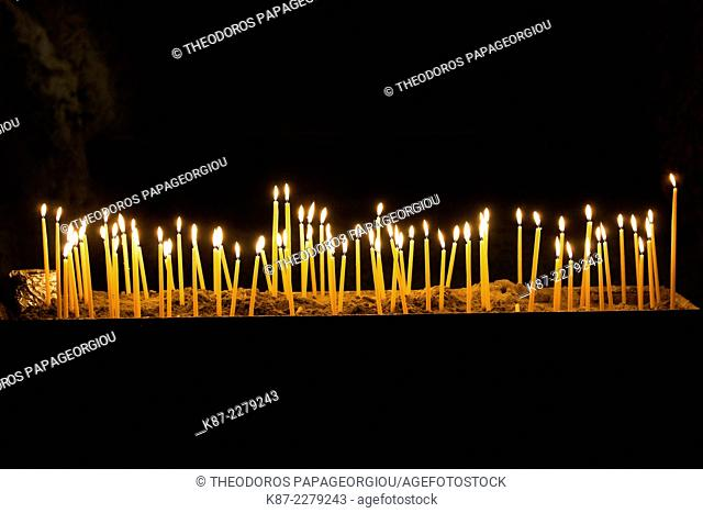 Candles in the cave church Panagia Kefalariotisa. Argolis, Peloponnese, Greece