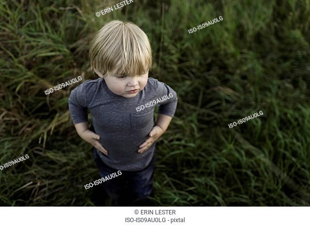 Young boy standing in field