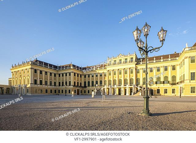 Vienna, Austria, Europe. The Schönbrunn Palace and the parade court at sunrise