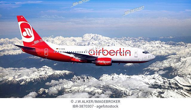 Air Berlin Boeing 737-73S in flight over the Alps, Switzerland