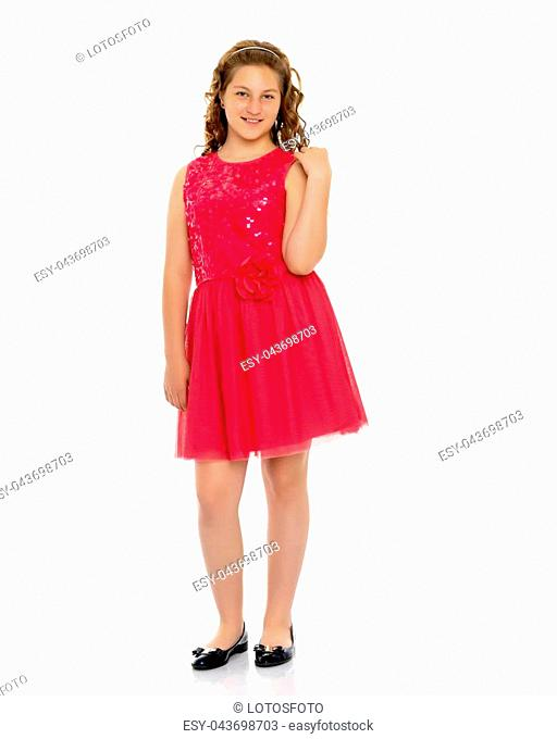 Elegant, beautiful girl in a dress. In full growth. The concept of youth fashion, happy childhood. Isolated on white background