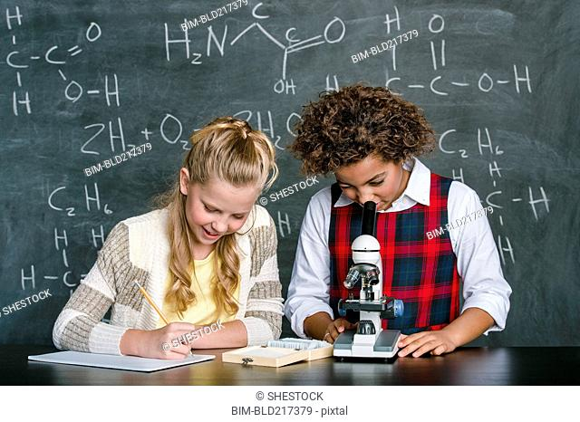 Students doing experiment in science class