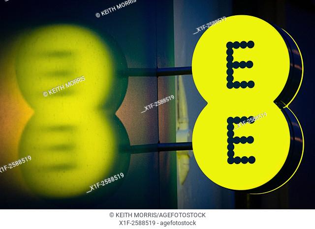 Illuminated sign logo for EE mobile network operator and internet service provider. UK