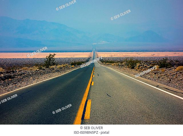 Straight road, cutting through open landscape, USA