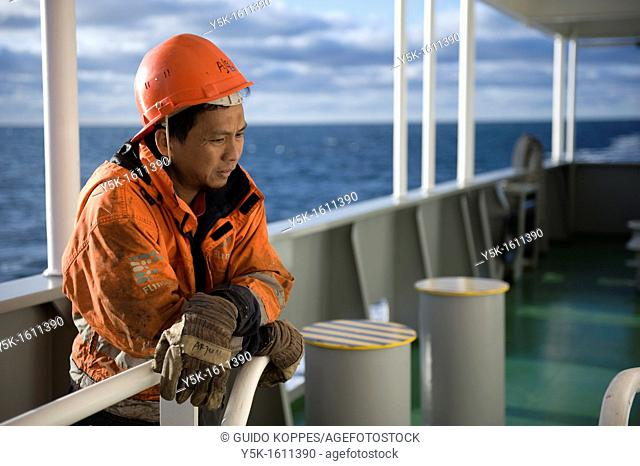 Portrait of an Indonesian seaman or sailor on the container-vessel MV Flintercape, during a journey from Rotterdam, Netherlands, to Sundsvall, Sweden