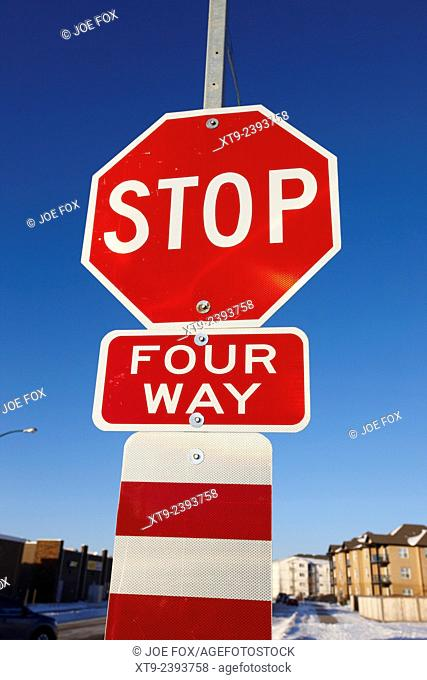 four way stop sign with crosswalk Canada