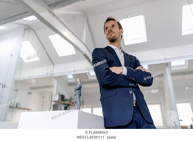 Businessman in office with his 3D look-alike