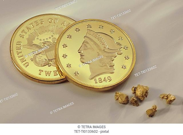 Gold coins and nuggets