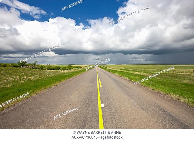 Storm clouds over highway near Val Marie, Saskatchewan, Canada