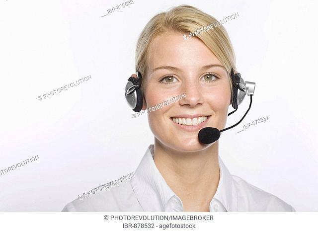 Young blond woman wearing a headset